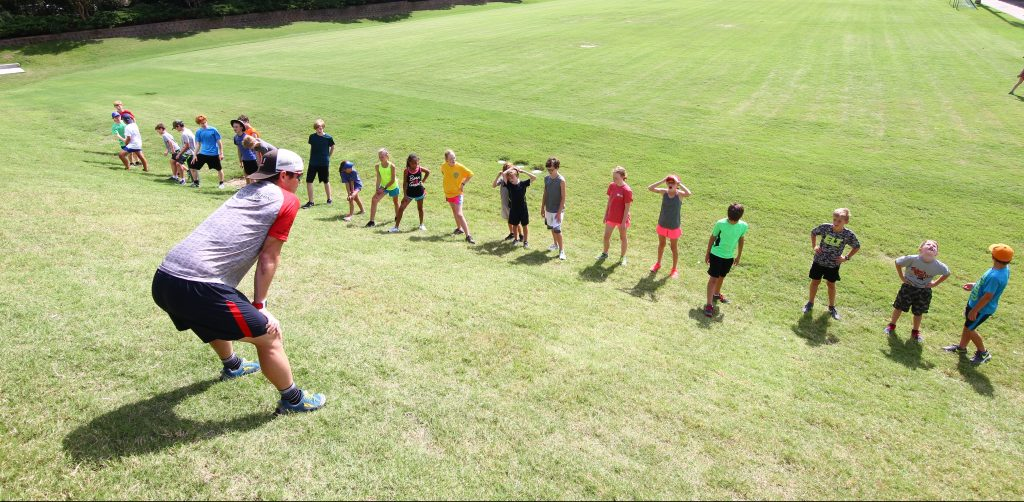 this is a photo of a coach training a group of endurance athletes