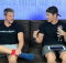 Triathlon Coach and a Pro Triathlete sitting on a couch